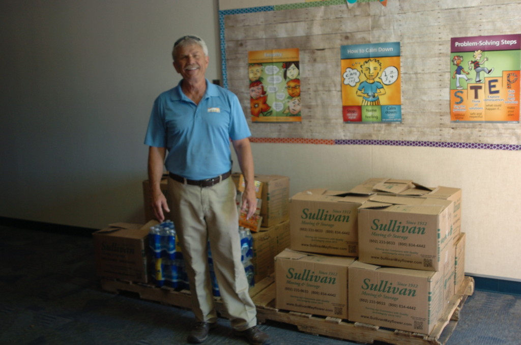 Mark King of King Home Inspections With Food Collected for the Kyrene Foundation